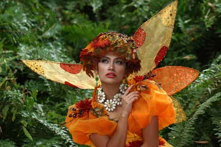 Asian model wearing an orange color fairy-tale costume having a fashion shoot Stock Photo