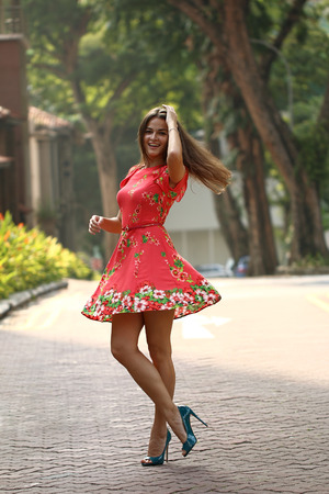 Young and beautiful woman model doing a fashion shoot outdoor