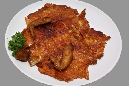 Boneless Chicken With Crispy Skin isolated on gray