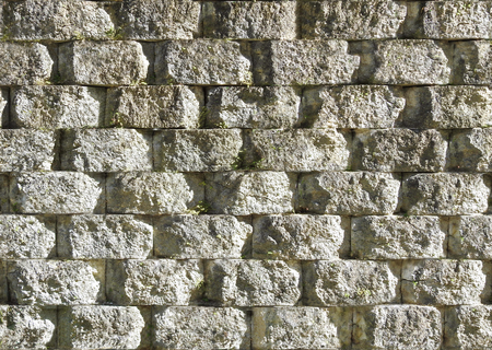 Seamless rough stone wall background texture