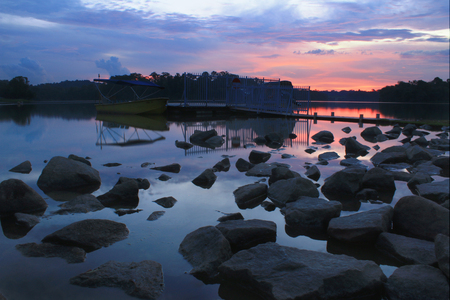 Singapore Pierce reservoir sunset with rocks in the foreground