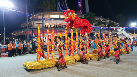 SINGAPORE - FEB 15 : Lion dance performance during Chingay parade at Singapore F1 Pit on Friday, February 15 2019. The Chingay is an annual Chinese New Year's festivities street parade and it is held at the F1 Pit Editorial