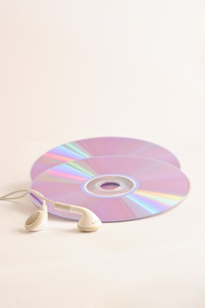 CD and headphone on white background photo