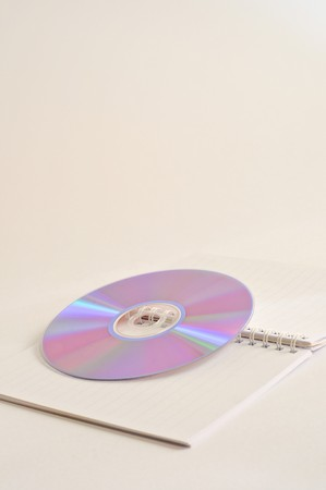 CD and Notebook on white background photo