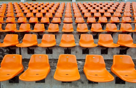 Front of the orange seats on the stadium photo