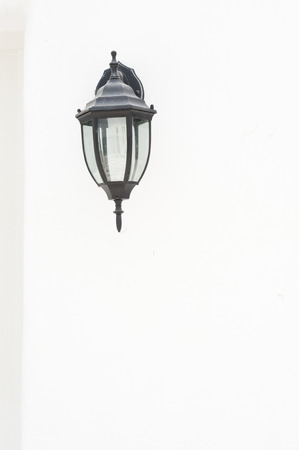 white concrete wall and classic lamp  photo