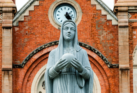 visitation: Statue of blessed virgin Mary outside of the church Stock Photo
