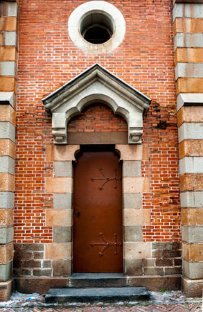 view of a wooden doorway: Old door of a church Stock Photo