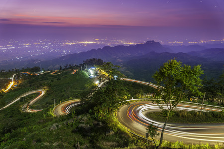 The light trails on the mountain street in morning, Thailand photo