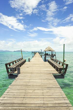 kood: Wooden pier on summer season - Wooden pier in Kho mak, Thailand Stock Photo