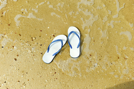 to flop: Flip flop on the beach Stock Photo