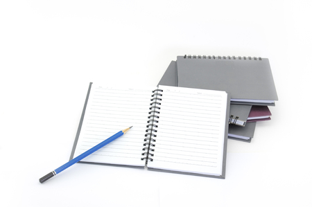 notebook: Notebook and pencil isolated on white background Stock Photo