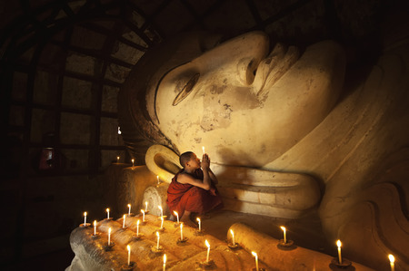 predominantly: BAGAN, MYANMAR - Nov 6: Unidentified young Buddhism novice pray on Nov 6, 2015 in Bagan. Buddhism is predominantly of the Theravada tradition, practised by 89% of the population.