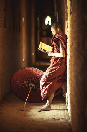 practised: BAGAN, MYANMAR - Nov 6: Unidentified young Buddhism novice pray on Nov 6, 2015 in Bagan. Buddhism is predominantly of the Theravada tradition, practised by 89% of the population.