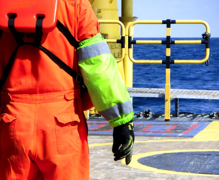 Signalman with green armband on the boat. Oil&Gas Banco de Imagens