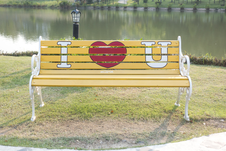 wooden bench: Red hearts painted on a white wooden bench. Love concept. Stock Photo