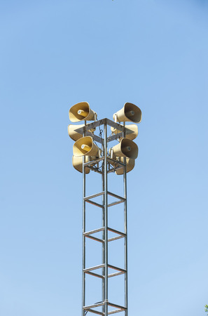 Many loudspeakers against cloudy blue sky Stock Photo