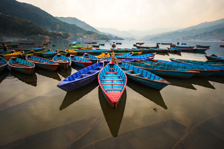 phewa: twilight with boats on Phewa lake, Pokhara, Nepal
