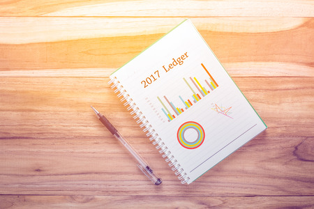 Top view notebook on wooden desk