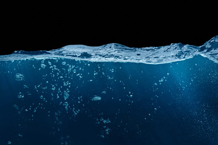 restless: restless blue water in the context of a black background.