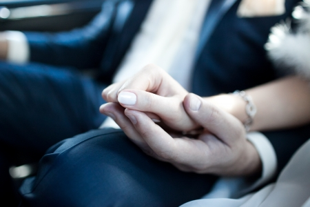 passion couple: Young married couple holding hands on wedding day