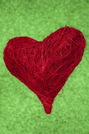 Red wool ball of yarn in heart form Banco de Imagens