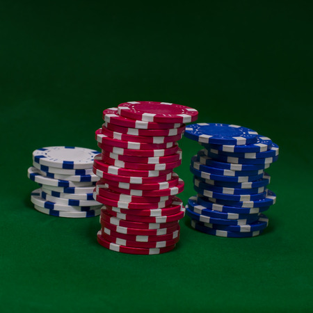 Casino chips on green table Banco de Imagens