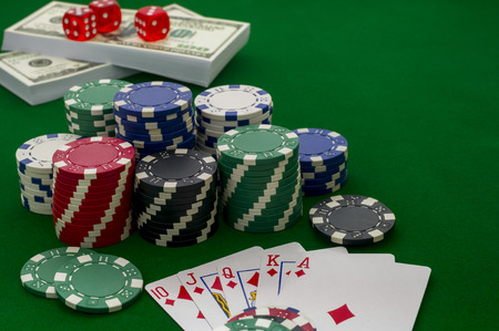 Chips for poker on the green background, shallow depth of field