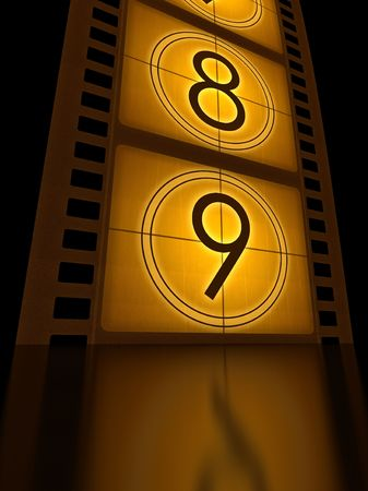 Filmstrip (countdown) standing on the reflective surface. Stock Photo