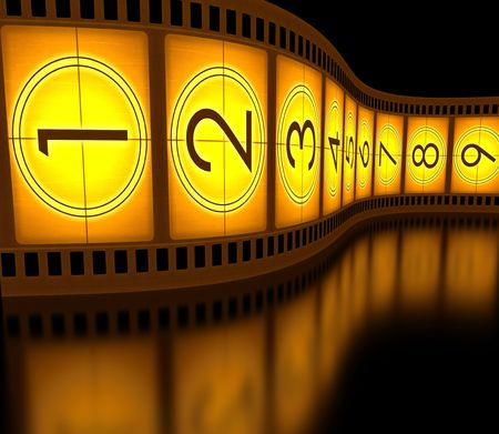 video still: Filmstrip (countdown) standing on the reflective surface. Stock Photo