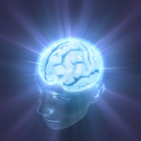 Head illuminated by the energy of the brain. Concept of thinking, the power of mind.