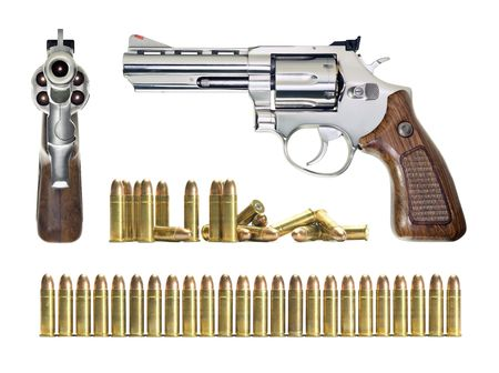Several objects in different positions of the gun and bullets. All objects are over white.