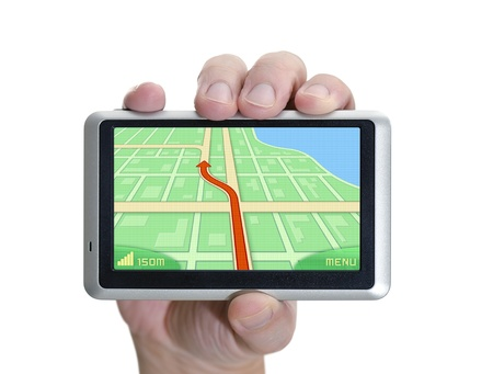 GPS device in hand over white.
