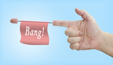 ammunition: Playing with the gun hand. The bang flag, comes out from the finger. Stock Photo