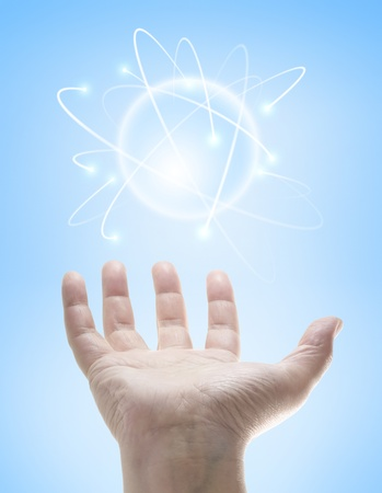 electrons: Power in the hands controlling a ball of energy. Stock Photo