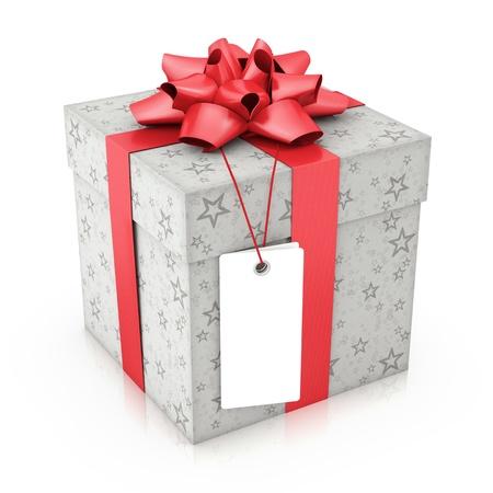dar un regalo: Regalo con etiqueta blanca. Su texto sobre el espacio en blanco. Foto de archivo