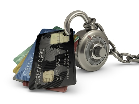 Credit card stuck in a lock code. Concept of protection against theft of your money. photo