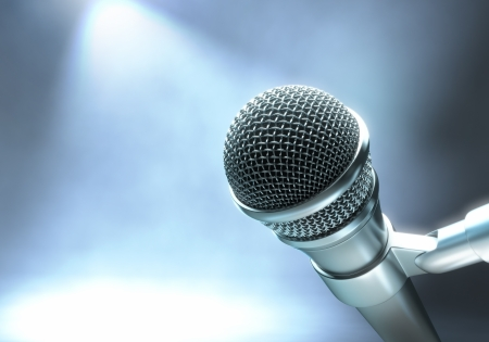 live performance: Modern microphone on a stage with lights for live performance.