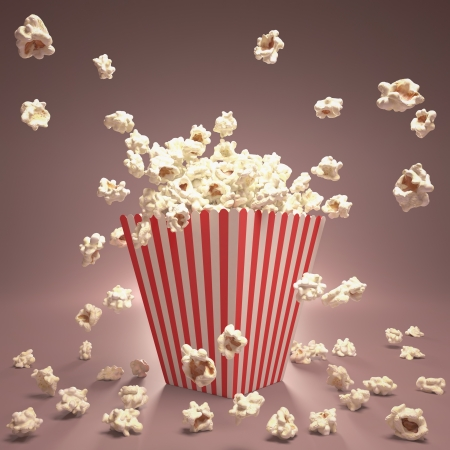 Popcorn exploding inside the packaging striped. Stock Photo - 15888713
