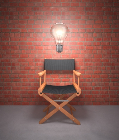 Lamp lit up on the director's chair. 免版税图像