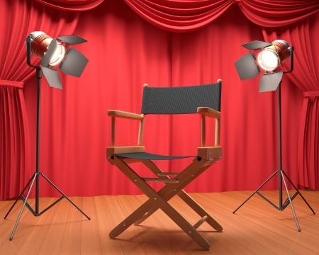 Directors chair on the stage illuminated by floodlights.