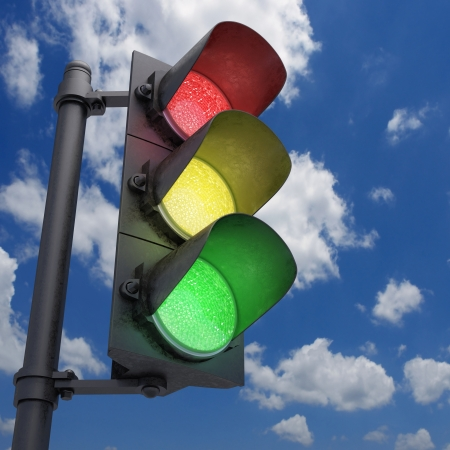 Traffic Light in a blue sky with all the lights on. Stock Photo