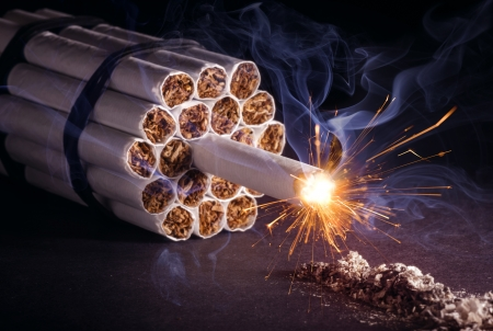Explosive addiction  A pack of cigarettes in the form of dynamite ready to explode  photo