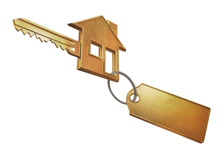 Golden key shaped like a house and a keychain unbranded for the logo. photo