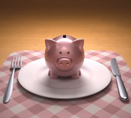 moneyed: Piggy bank on the plate ready to be opened.