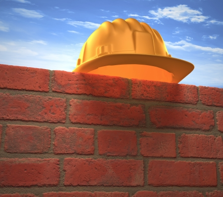 Protective helmet on a brick wall. Your text or logo on the wall. photo