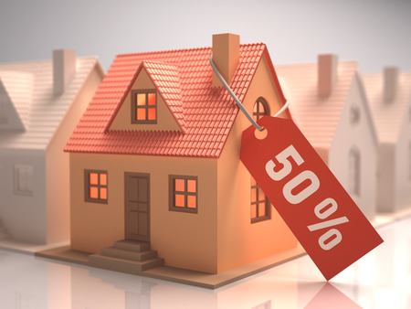 liquidation: Small house with red label written 50%. Stock Photo