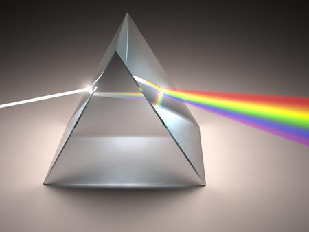 El prisma de cristal dispersa la luz blanca en los varios colores. Foto de archivo