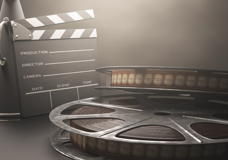 film: Clapperboard with rolls of film in the retro concept cinema. Stock Photo