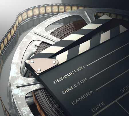 Clapperboard with rolls of film in the retro concept cinema. photo